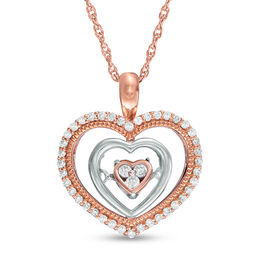 Unstoppable Love™ 1/6 CT. T.W. Composite Diamond Triple Heart Pendant in 10K Two-Tone Gold