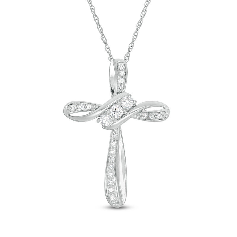 3f39f63d18c92 1/4 CT. T.W. Diamond Three Stone Bypass Cross Pendant in 10K White  Gold|Zales Outlet